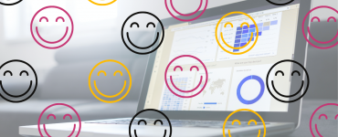 smiley faces on surrounding a laptop screen with graphs